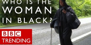 Who is the mysterious woman in black walking across the US?