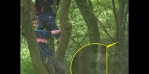 """Mother spots 'GHOST CHILD' in family SNAP"" of her children climbing a tree during day out."