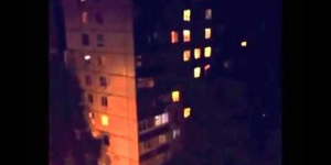 Slenderman? Stick creature cliimbs building in Russia